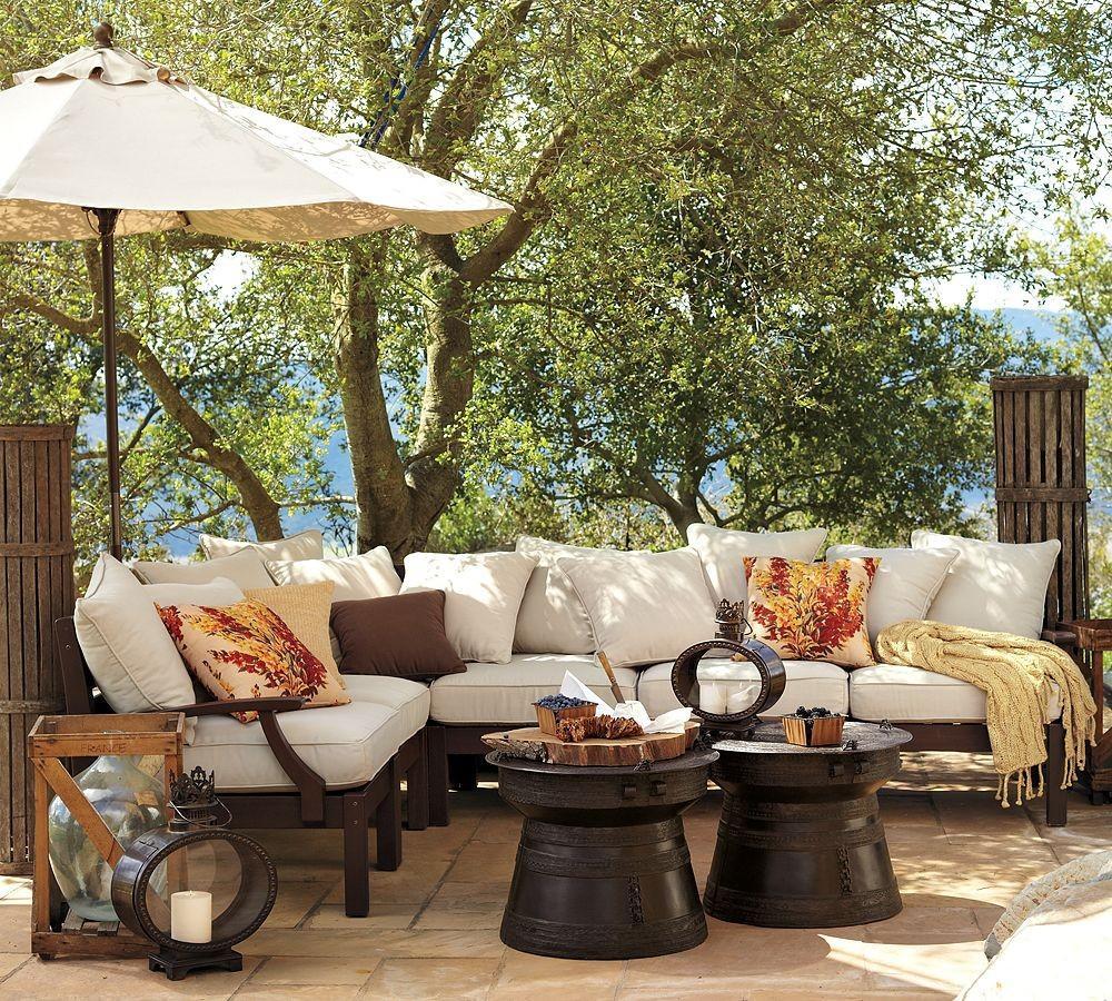 pottery-barn-outdoor-dark-wood-furniture-under-big-tree-feeling-fresh