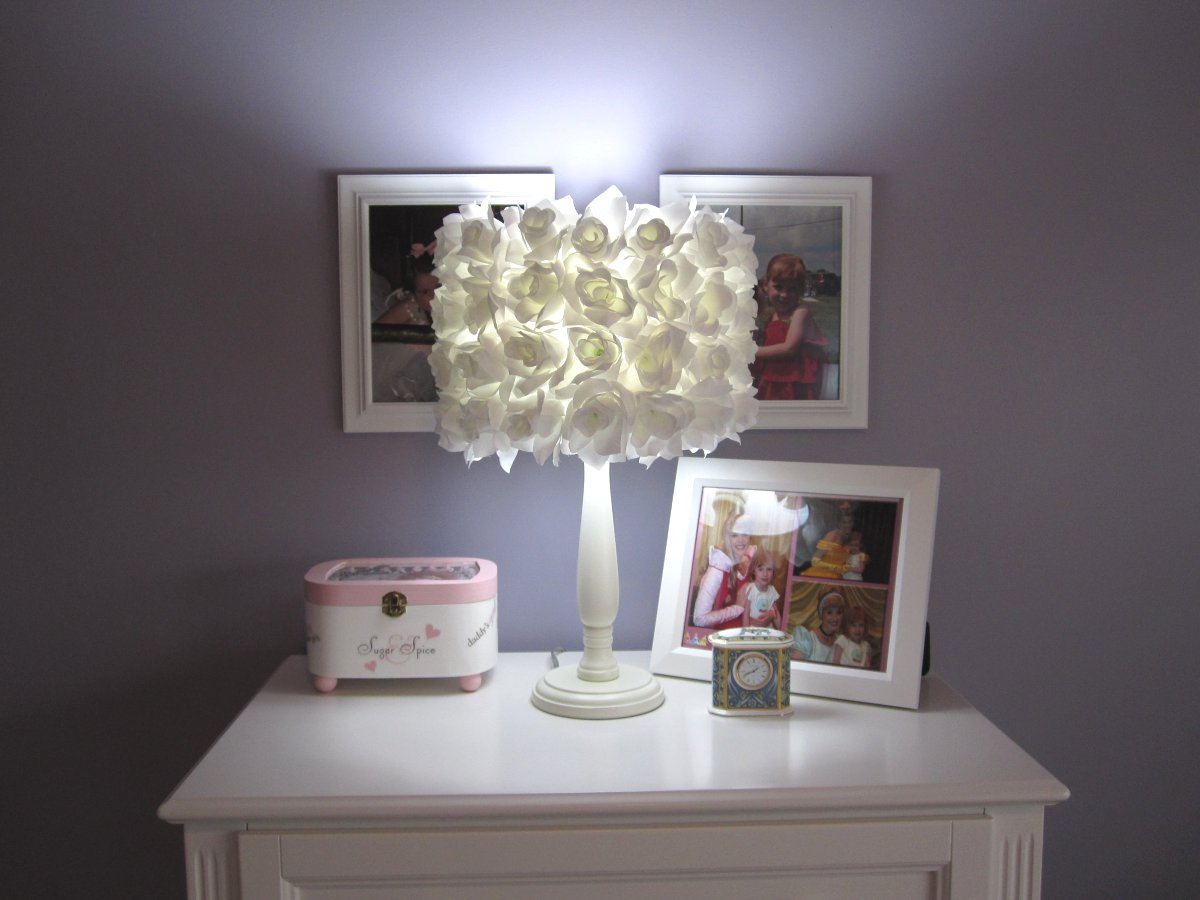 ruffle-small-white-lamp-shades-over-square-white-wooden-table-with-picture-frames